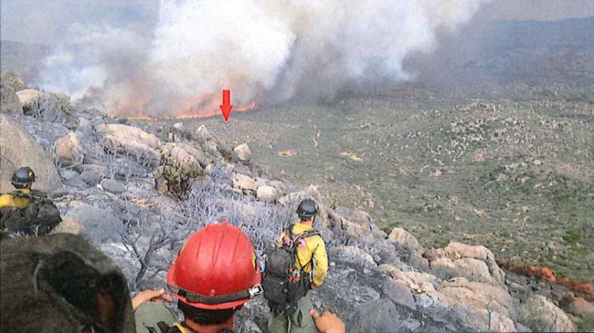 A photo taken by the Granite Mountain Hotshots on June 30 shows their position on a ridge, with a red arrow indicating the original location of their lookout. The crew's lookout was the only team member to survive the fire. Chris MacKenzie/Granite Mountain Hotshots