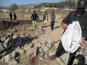 Pakistani security personnel examine the site of a suicide bombing in the Ibrahimzai area of Hangu, Pakistan, on Monday. The bombing killed 15-year-old Aitizaz Hasan, who prevented the bomber from attacking a school. Basit Shah/AFP/Getty Images