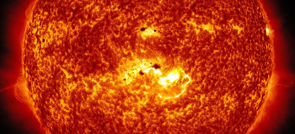 Coming At You: An image created by NASA combines two pictures from its Solar Dynamics Observatory. One shows the location of a large sunspot; the other shows Tuesday's massive solar flare. NASA/SDO
