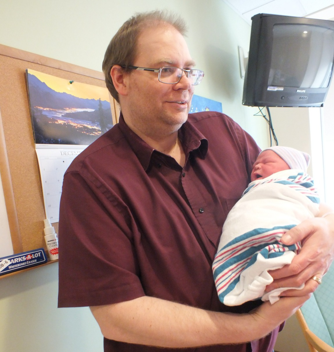 The first Juneau baby of 2014, Jeshua Moreno, with dad John. Photo by Casey Kelly/KTOO.