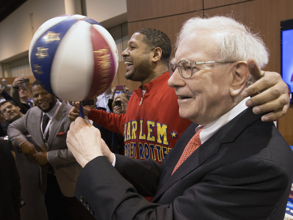 "Warren Buffett with Harlem Globetrotter Chris ""Handles"" Franklin at Berkshire Hathaway's annual meeting in May 2013. Nati Harnik/AP"