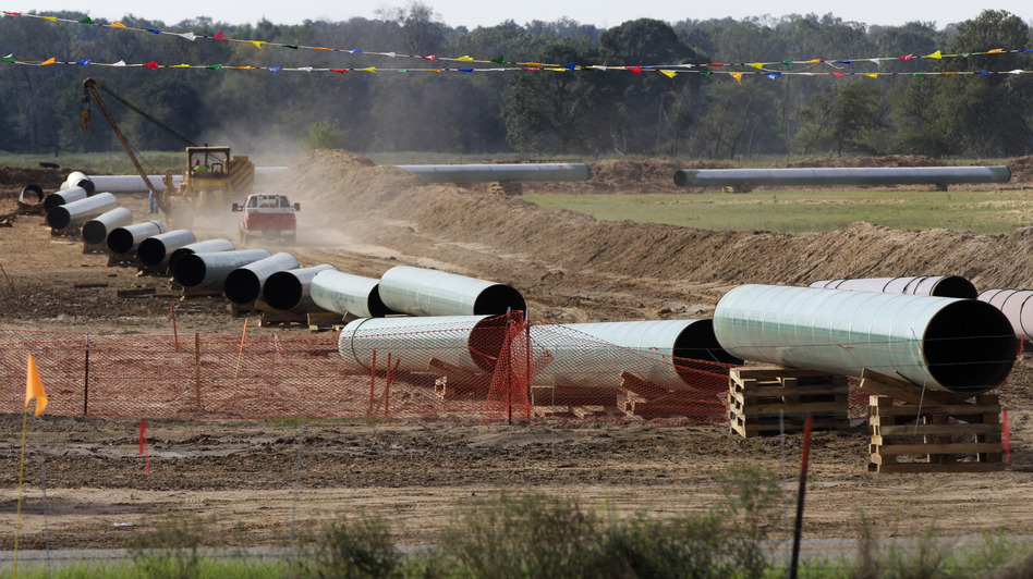 A 2012 photo shows sections of pipe on a neighboring property to Julia Trigg Crawford family farm in Sumner Texas, in the path of the Keystone pipeline. TransCanada said today that it is delivering oil through the Gulf Coast portion of its proposed Keystone XL pipeline, from a hub in Cushing, Okla., to Houston-area refineries. Tony Gutierrez/AP