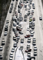 Abandoned cars sit on Interstate 75 in Atlanta. Traffic halted Tuesday during an ice and snow storm. Two days later, drivers can start retrieving their vehicles. David Tulis/AP