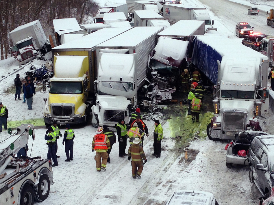 Emergency crews work at the scene of a massive pileup Thursday involving more than 40 vehicles, many of them semitrailers, along Interstate 94. AP