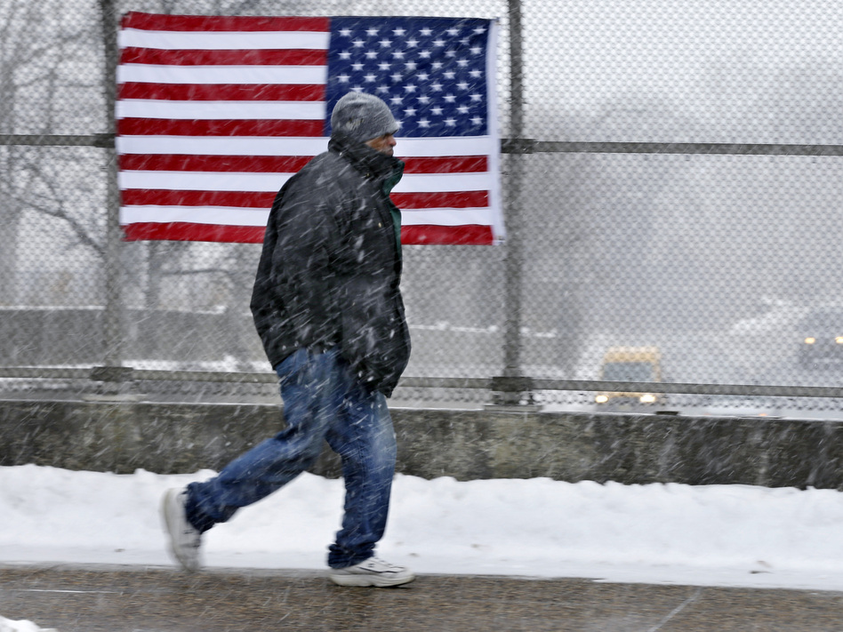 A man walks across a bridge in Trenton, N.J., on Saturday. More cold weather is headed his way. Mel Evans/AP