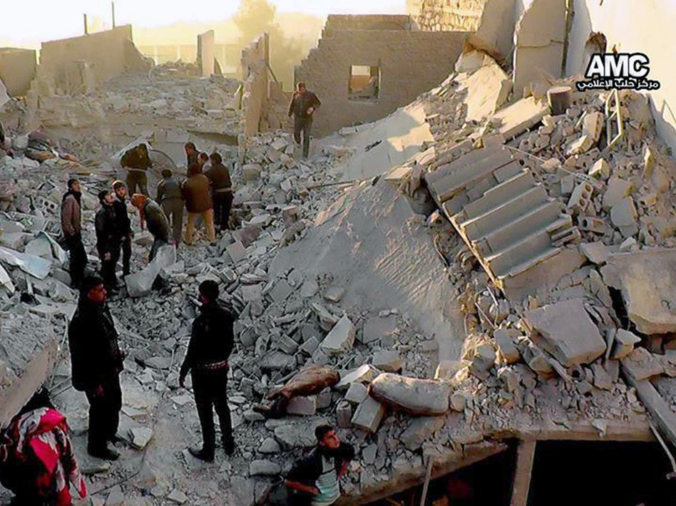 Syrians inspect the rubble of destroyed buildings following a government airstrike in Aleppo, in this image provided Monday that was taken by a citizen journalist. AP