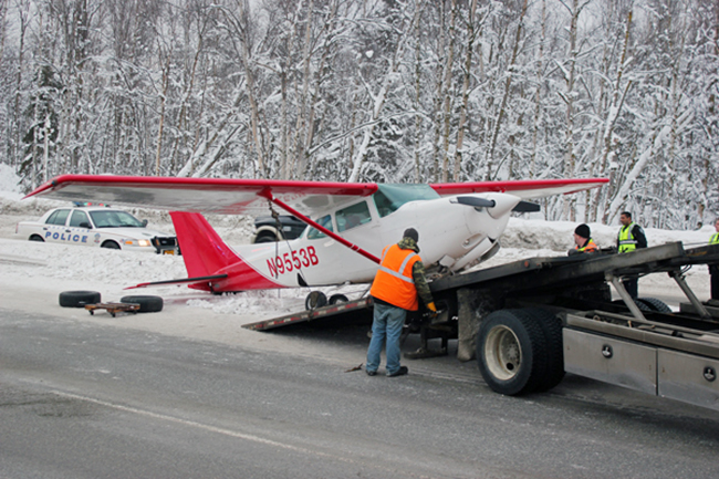 Crews load the Cessna 172 Cutlass onto a tow truck. (Photo by Josh Edge, APRN – Anchorage.)