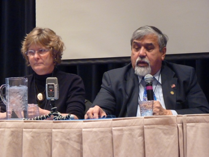Rep. Bill Thomas answers a question as Rep. Beth Kerttula listens during a 2011 form at Juneau's Centennial Hall. (Ed Schoenfeld, CoastAlaska News)