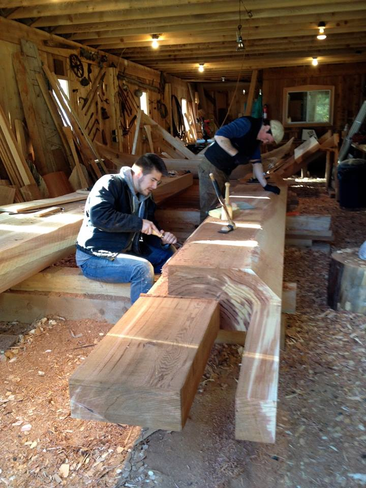 Eric Hammer (front) and Harley Bell-Holter work in Kasaan's carving shed. (Courtesy Organized Village of Kasaan)