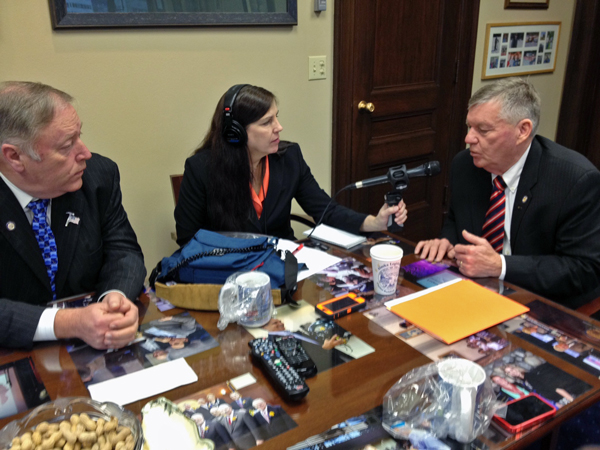 APRN's Lori Townsend speaks with House Speaker Mike Chenault and Senate President Charlie Huggins. (Photo by Annie Feidt, APRN)