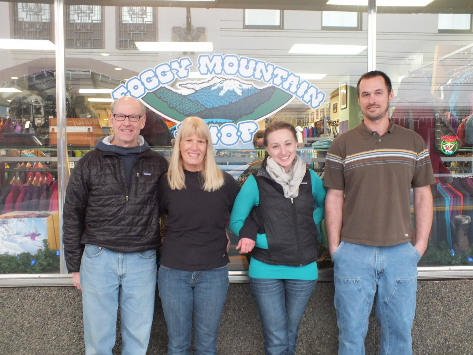 Former Foggy Mountain Shop owners Scott and Betsy Fischer with new owners Courtney Nicholl and Sean Rielly just hours after the store changed hands on Monday. Photo by Casey Kelly/KTOO.