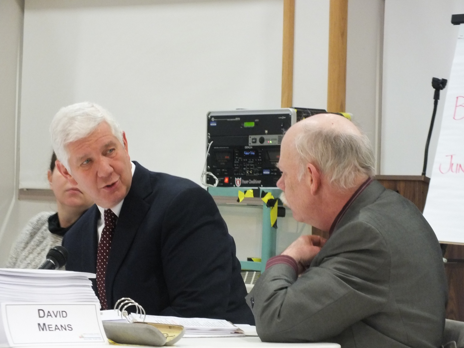 Juneau School District Superintendent Glenn Gelbrich talks with district Administrative Services Director David Means Tuesday at the district Budget Committee meeting. Photo by Casey Kelly/KTOO.