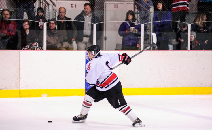 Juneau defenseman Shane Moller winds up for a shot from the point during the second of two games versus Monroe Catholic.
