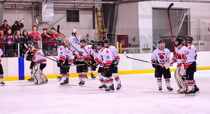 Juneau players deliver a final salute to their fans Saturday night after sweeping Monroe Catholic, 3-0 and 5-3.