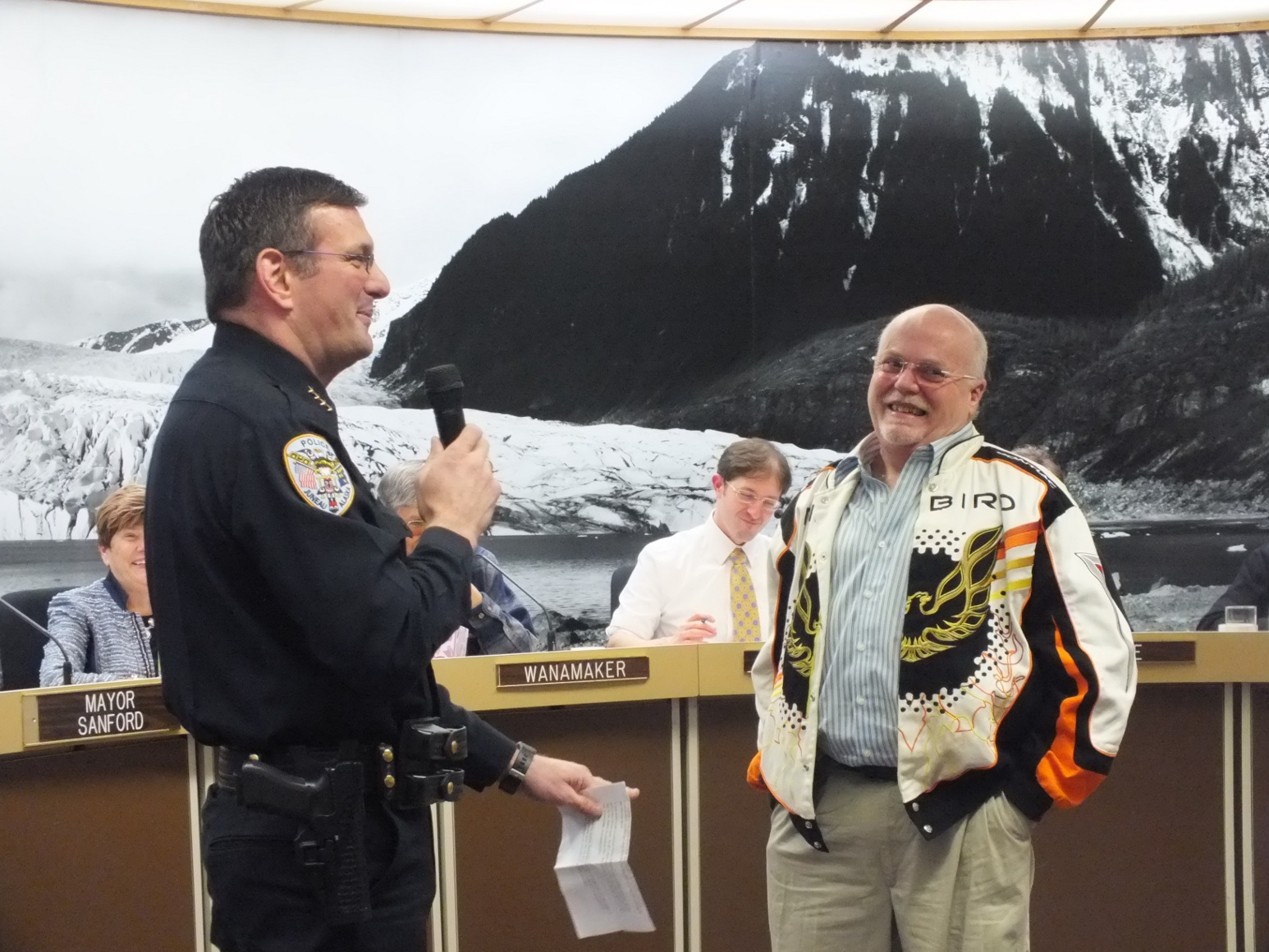 Juneau Police Chief Bryce Johnson jokes with longtime JPD mechanic Scott Phillips about his retirement after 30 years with the city. Photo by Casey Kelly/KTOO.