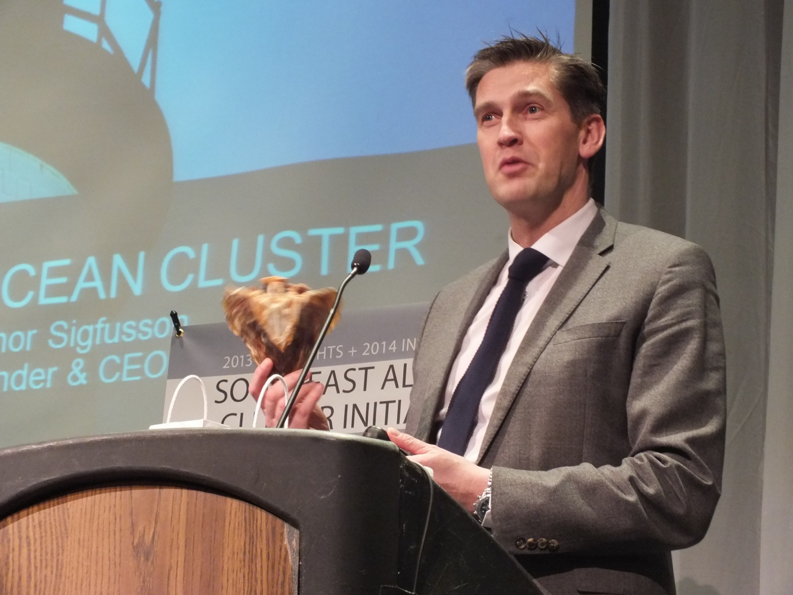 "In 2011, Thor Sigfusson (shown here holding a dried cod head) founded the Iceland Oceans Cluster, which he calls the ""greatest dating service"" for businesses in Iceland's fishing industry. Photo by Casey Kelly/KTOO."