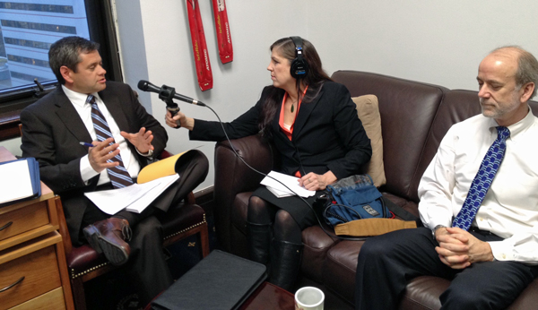 APRN's Lori Townsend speaks with Chris Tuck and Hollis French. (Photo by Annie Feidt/APRN)