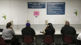 The lines were busy last September at an unemployment insurance phone bank operated by the California Employment Development Department in Sacramento. Rich Pedroncelli/AP