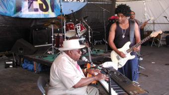 Chris Thomas King plays on the House of Blues stage with his father, Tabby Thomas, in 2001, at the New Orleans Jazz and Heritage Festival. Douglas Mason/AP