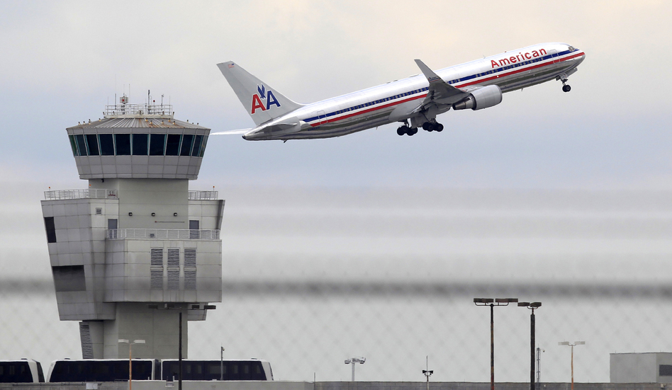 An American Airlines Boeing 767 takes off from Miami International Airport. Wilfredo Lee/AP