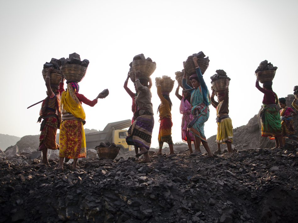 Local villagers scavenging coal illegally from an open-cast mine in a village near Jharia, India, in 2012. Daniel Berehulak/Getty Images