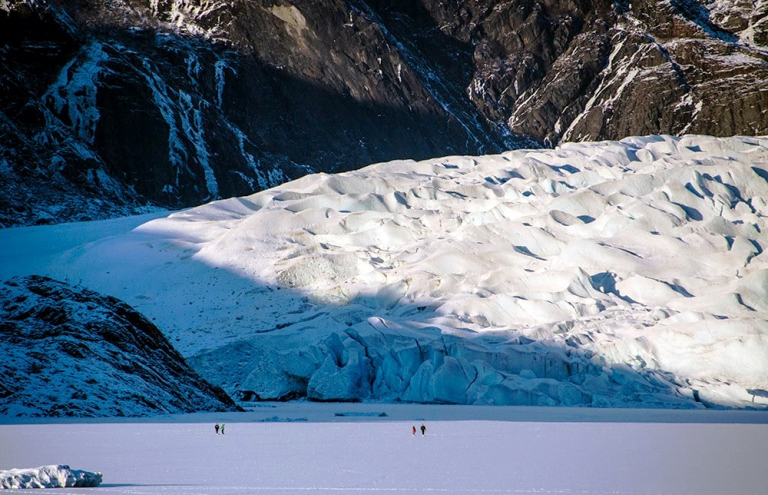 People on the ice in front of Mendenhall Glacier. (Photo by Heather Bryant / KTOO)