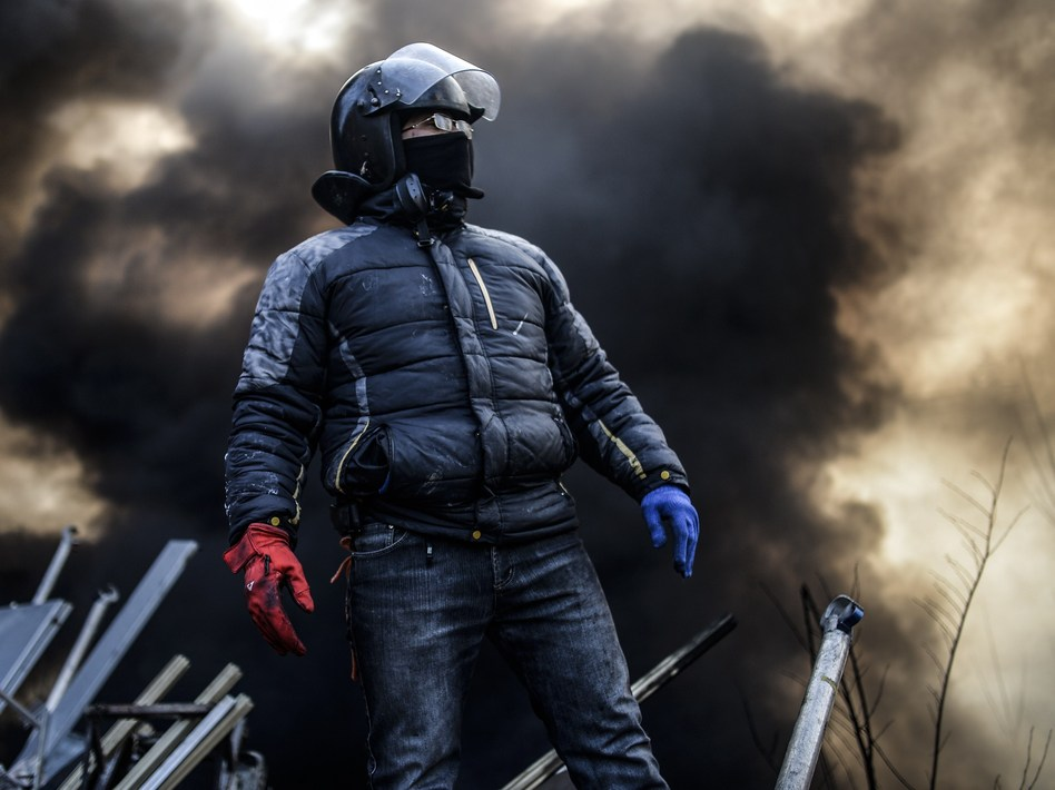 Even as word was emerging about a possible end to the crisis, anti-government protesters remained in Kiev's Independence Square early on Friday. (Bulent Kilic /AFP/Getty Images)
