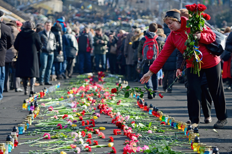 In Kiev's Independence Square, flowers have been left in memory of protesters killed there in recent days. Jeff J Mitchell/Getty Images