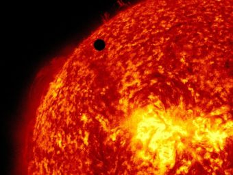 A view of Venus, black dot at top center, passing in front of the sun during a transit in 2012. A quarter of Americans questioned failed to answer correctly the most basic questions on astronomy. AP
