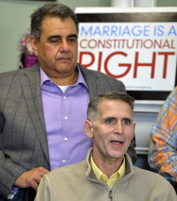 Greg Bourke, front, and his partner Michael Deleon speak to reporters following the announcement from U.S. District Judge John G. Heyburn striking down part of Kentucky's same-sex marriage ban. Timothy D. Easley/AP