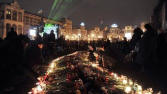 People light candles to honor victims of recent clashes between protesters and police on Independence Square in Kiev Monday. NATO and Russian officials shared their concerns about Ukraine's stability. Louisa Gouliamaki/AFP/Getty Images