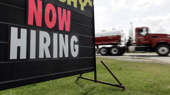 As the weather warms, while more signs such as this pop up? Economists say the latest data on claims for unemployment benefits may signal that better times are ahead. (Eric Gay/AP)