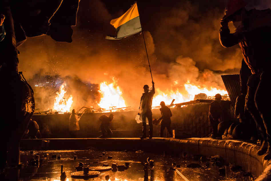 Anti-government protesters guard the perimeter of Independence Square, known as Maidan, on Tuesday in Kiev, Ukraine. Police in Ukraine's capital attacked an opposition camp that's been the center of the massive anti-government protests that began last November. Brendan Hoffman/Getty Images