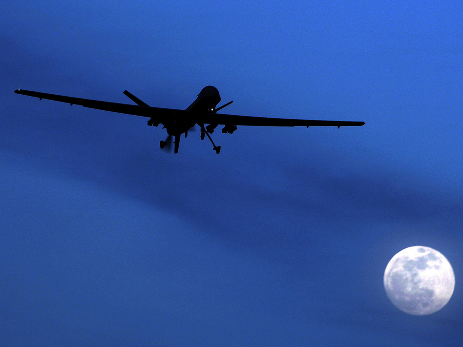 A U.S. drone in the sky over Kandahar Air Field in Afghanistan. Kirsty Wigglesworth/AP