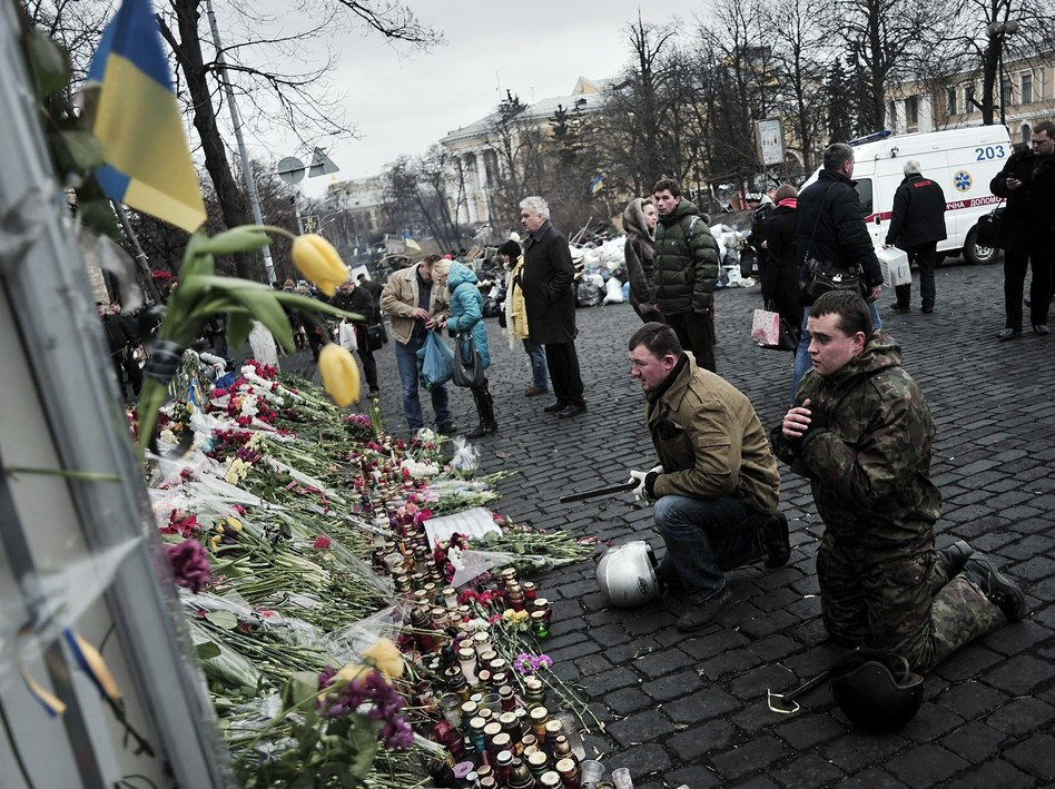 Praying for those who died: Mourners were in Kiev's Independence Square again on Tuesday. It was the site of protests in recent months, and was where more than 80 people died last week in violence blamed on security forces. Louisa Gouliamaki /AFP/Getty Images