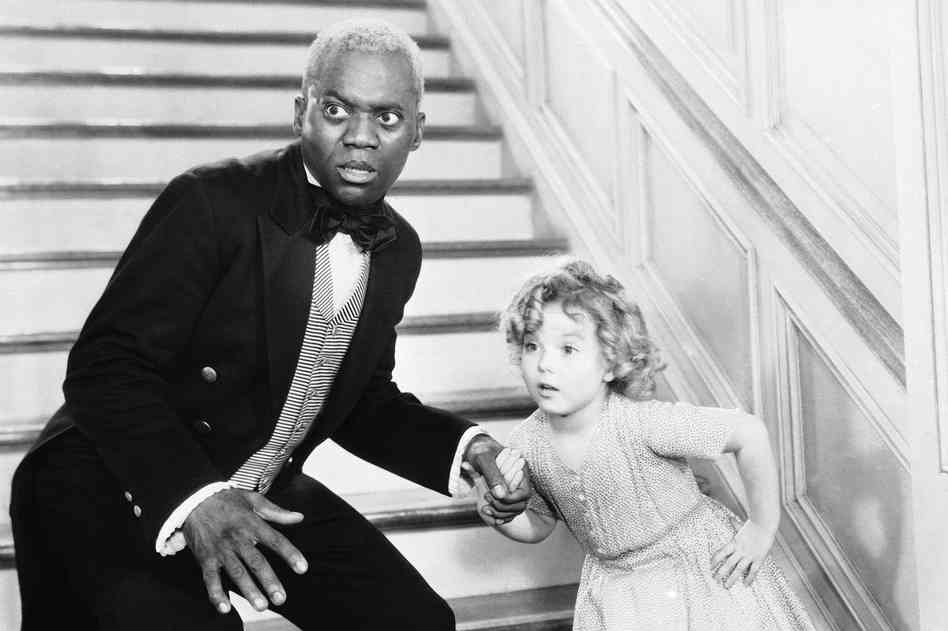 Bill Robinson, as the butler, teaches Shirley Temple his world-famous stair dance in a scene from The Little Colonel in 1935. AP