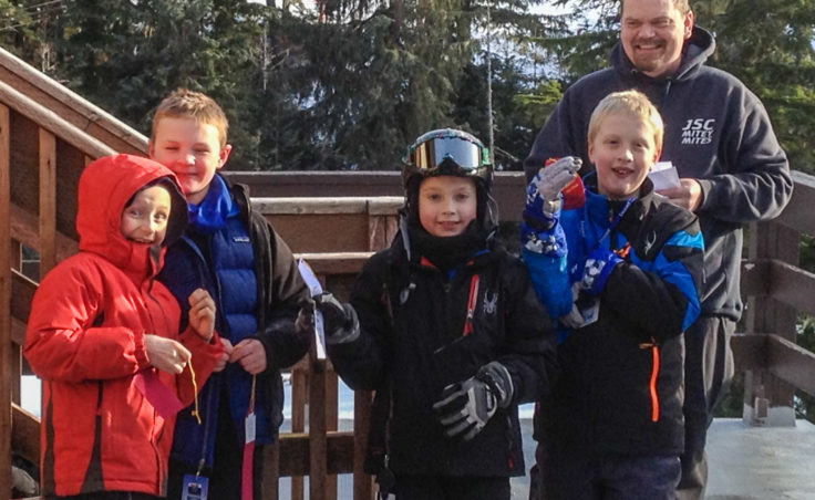 The Falcons ski group with coach Mike Satre. (L-R) Malachi Peimann, age 8; Sage Richards, 8; Karter Kohlhase, 8; and Adrian Whitney, 9. (Photo courtesy Dana Richards)