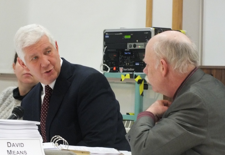 Glenn Gelbrich talks with district administrative service director David means at a budget meeting. (File photo.)