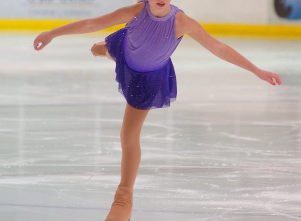Sadie Murphy balances on a single blade in the Free Skate 2 competition at Treadwell Ice Arena.
