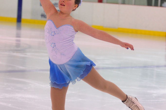 Katie McKenna strikes a graceful pose during her Free Skate 2 routine at Treadwell Ice Arena.
