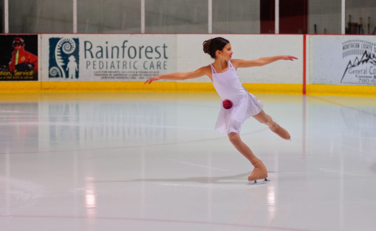 Megan Renkes glides while kicking off the events titled well-balanced at Treadwell Ice Arena.