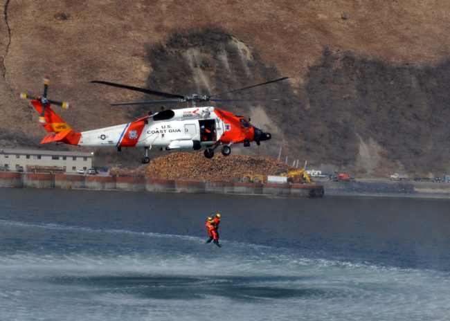 MH-60 Jayhawk helicopter crews perform a search and rescue demonstration off the back of the Coast Guard Cutter Munro April 15, 2013, in Womens Bay, Kodiak, Alaska. (U.S. Coast Guard photo by Petty Officer 3rd Class Jonathan Klingenberg.)