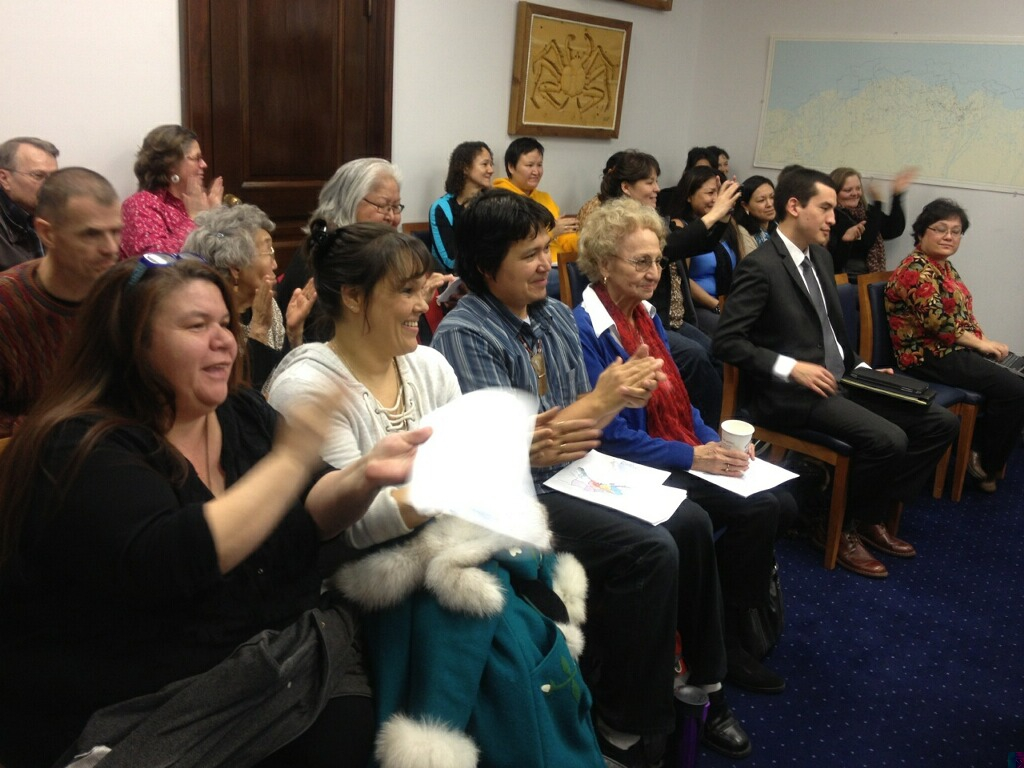 The Barnes Committee Room erupts in applause after an Alaska House committee advanced legislation that would make 20 Alaska Native languages official state languages on on Feb. 18, 2014.