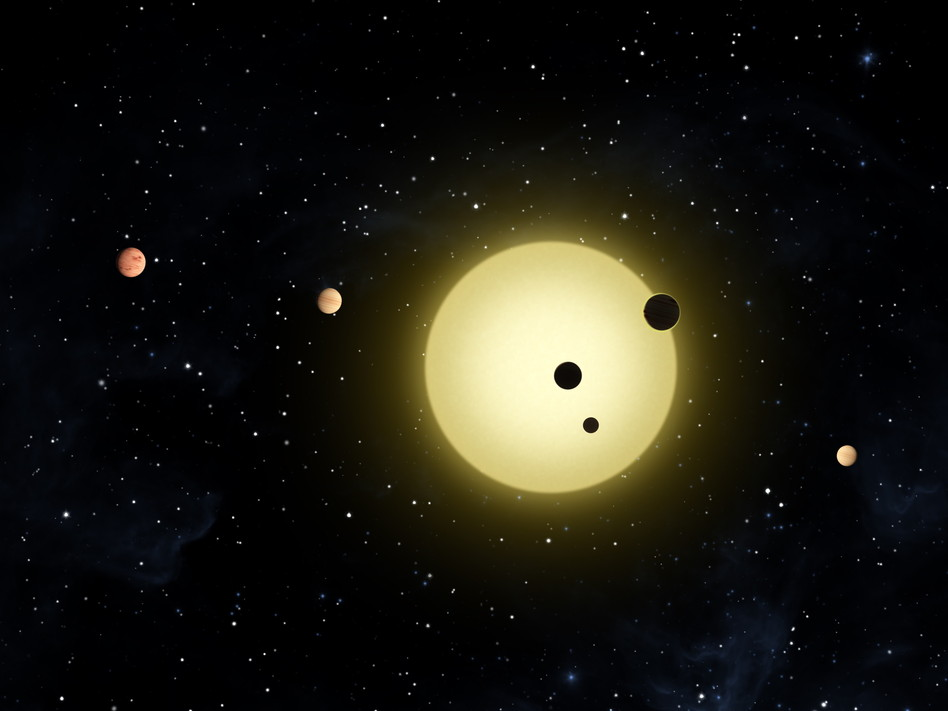 This artist rendering provided by NASA, shows Kepler-11, a sunlike star around which six planets orbit. AP