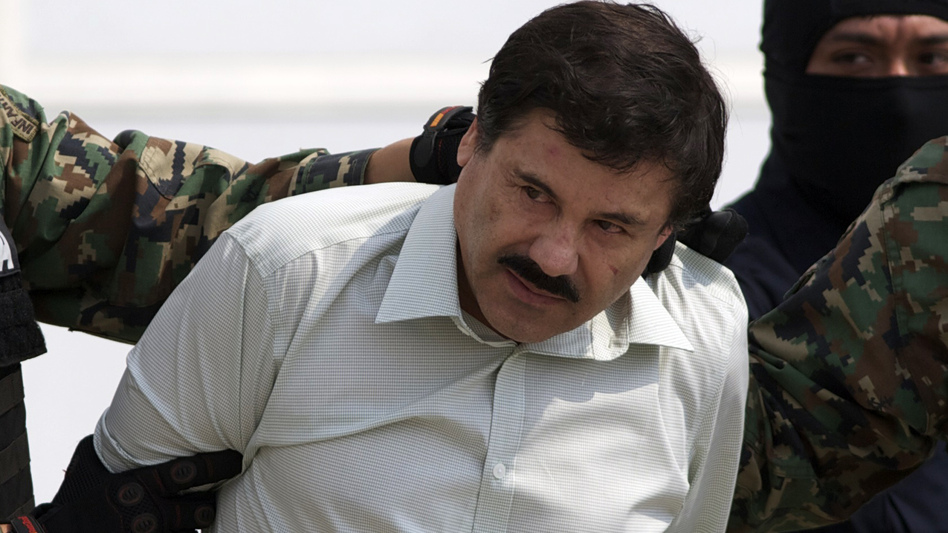 "Joaquin ""El Chapo"" Guzman is escorted to a helicopter in handcuffs by Mexican navy marines at a navy hanger in Mexico City on Saturday. A senior U.S. law enforcement official said that Guzman, the head of Mexico's Sinaloa Cartel, was captured alive overnight in the beach resort town of Mazatlan. Eduardo Verdugo/AP"