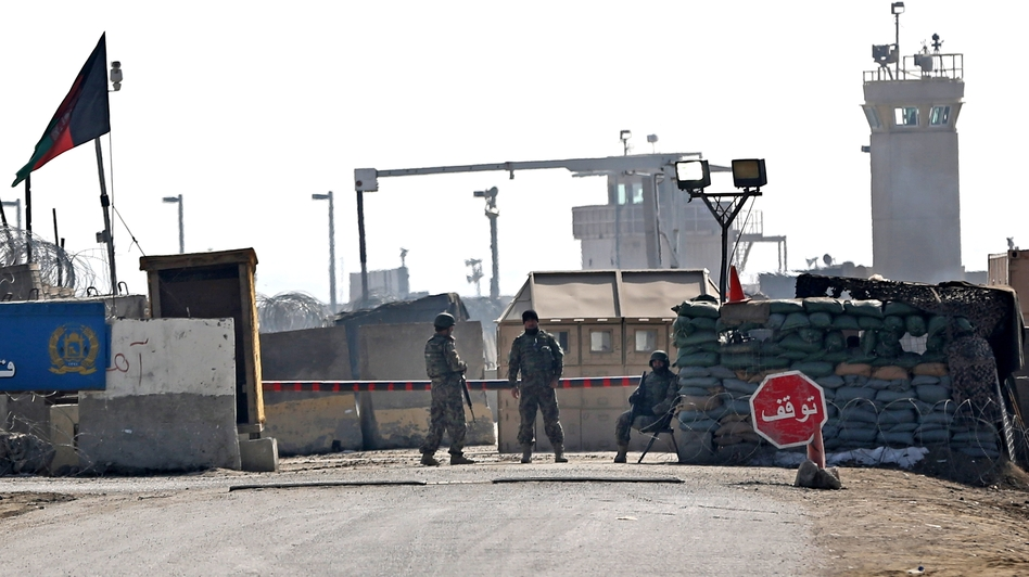 Afghan National Army soldiers stand guard at the main gate of the Parwan Detention Facility Center on the outskirts of Bagram. Afghan authorities released 65 prisoners from there Thursday. Massoud Hossaini/AP