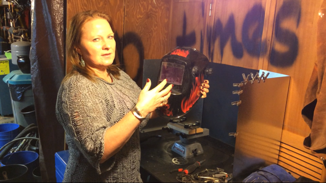 Teresa Busch with her welding helmet. Photo by Scott Burton.