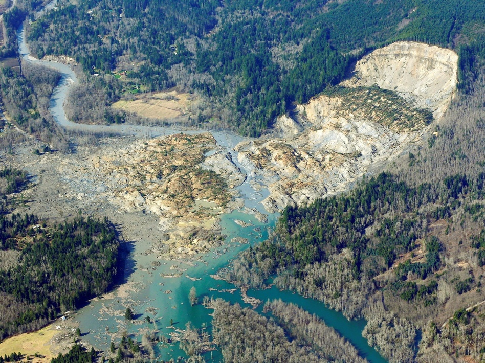 The massive mudslide that killed at least eight people and left dozens missing is shown in this aerial photo, on Monday, near Arlington, Wash. Ted S. Warren/AP