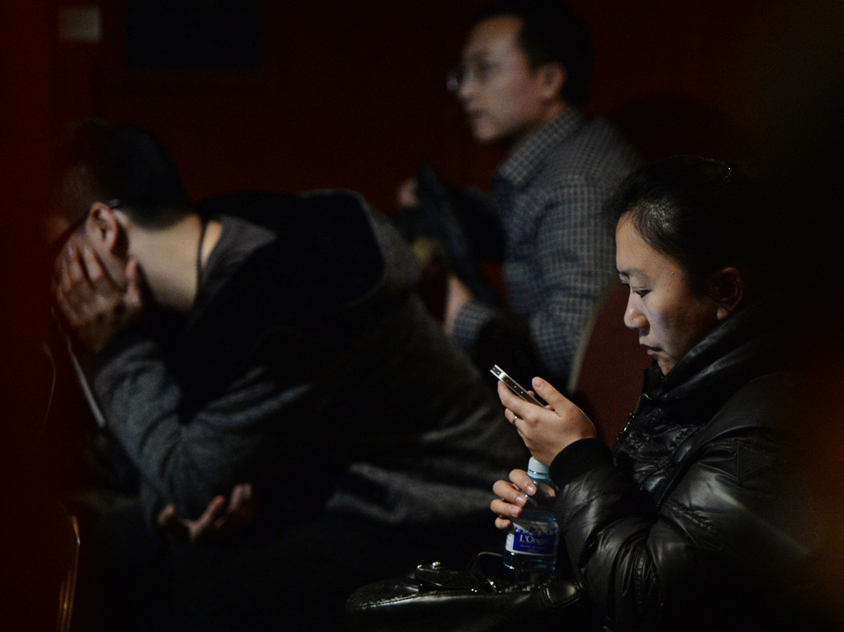 In Beijing, anxious relatives continue to wait for word about the fate of Malaysia Airlines Flight 370. The Beijing-bound jet disappeared on Saturday. Mark Ralston /AFP/Getty Images