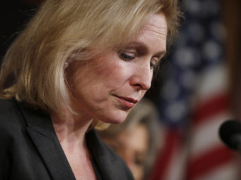 Sen. Kirsten Gillibrand (D-NY) pauses while speaking at a news conference on Capitol Hill in Washington, on Thursday following the Senate vote on the military sexual assaults bill she sponsored. Charles Dharapak/AP